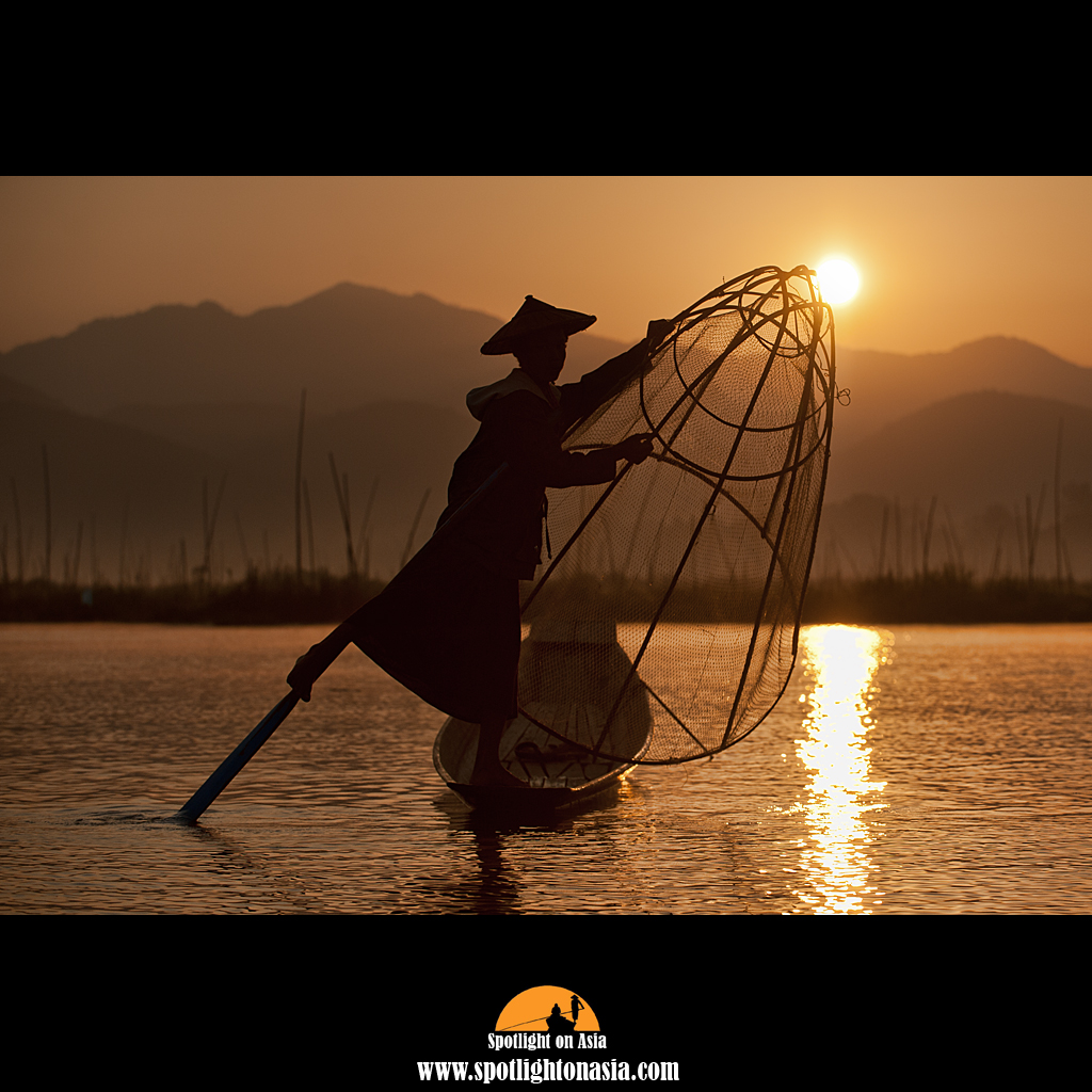 Photo: The fisherman on Inle Lake have a traditional fishing method and row with one leg. It is like watching a ballet couple balancing and and dancing around in the morning light.
