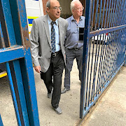 Professor Peter Beale, right, and the late Dr Abdulhay Munshi after appearing in the Johannesburg magistrate's court in August.