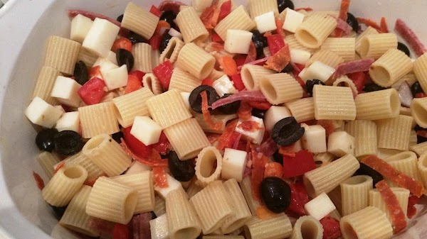 Cook pasta according to box.  In a small bowl, mix seasonings, oil, vinegar, sugar. Set...