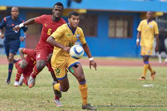 Photo: Quentin RUSHENGUZIMINEGA (10) pursued by Affriyea Acqua (6) [Rwanda Vs Ghana AFCON2017 Qualifier, 5 Sep 2015 in Kigali, Rwanda.  Photo © Darren McKinstry 2015