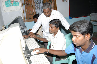 Photo: Young boys develop digital skills by operating the computers