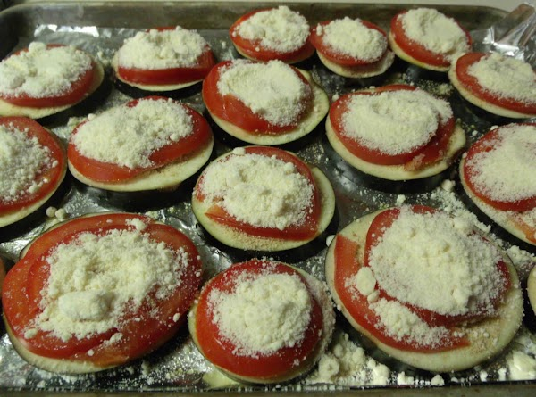 Using the teaspoon again, top each tomato with a liberal amount of parmesan cheese....
