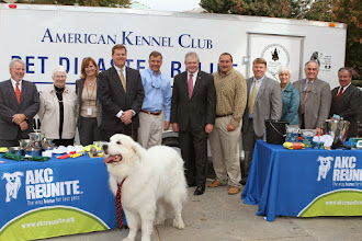 Photo: (L to R) Patrick and Almira Dallas, Dallas Harsa (AKC Reunite), Tom Sharp (CEO, AKC Reunite), Bill Gentry (UNC School of Public Health),Mike Sprayberry (Emergency Management Director), Chris Murray (Pamlico County Emergency Management), Ellis Boyle (Deputy Secretary, Dept. of Agriculture), Sharron Stewart (Director, Emergency Programs, Dept. of Agriculture), Chester Lowder (NC Farm Bureau)and Dr. Mike Yoder (NCSU)...and Vern the Great Pyrenees  Credit: Robert Young (c) American Kennel Club