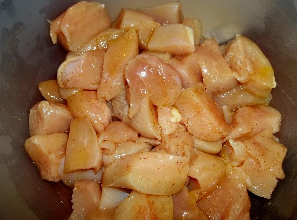In another bowl, coat chicken with oil.