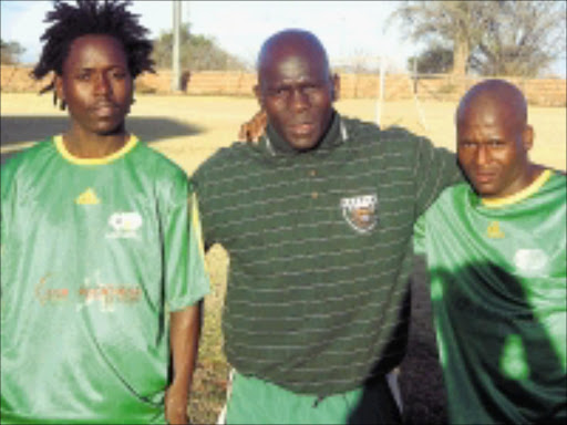 FIRE-POWER: Baroka FC's recruits, Jabulani Ntombela, left, and Khumbulani Mdluli flank head coach Moshibudi Mabitsela at training yesterday. Pic. Matome Lebea. 29/07/08. © Sowetan.