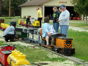 Photo: Paula Businger watching Spence Gaskin put his passenger car on the train.  Watching is Stephanie Gaskin and Rich Businger    HALS Chili Fest Meet 2014-0301 RPW