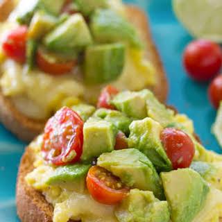 Cheesy Scrambled Egg Toast with Avocado Cherry Tomato Medley.