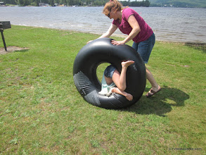 Photo: Rolling her daughter in a tube across the grass