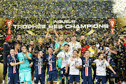 Team of Paris Saint-Germain celebrates the victory with the trophy during the 2019 Trophee des Champions between Paris saint-Germain and Stade Rennais FC at Shenzhen Uniersiade Sports Center on August 3, 2019 in Shenzhen, China.