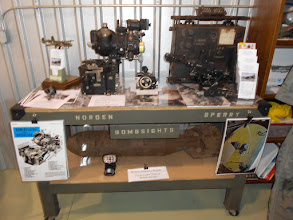 Photo: An overall view of the main display area - Norden and Sperry bombsights, radio, and other items.