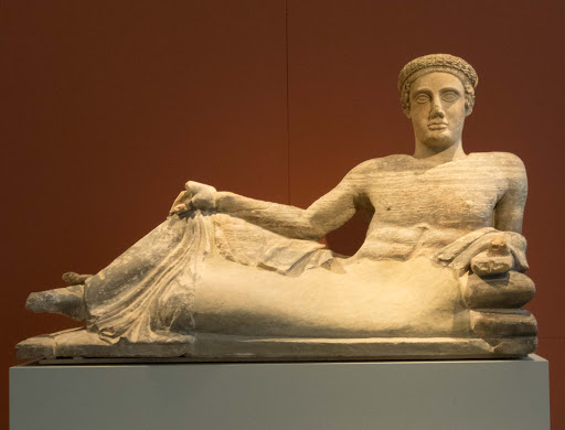 Cinerary Urn: Reclining young man dates to 440-460 B.C. in the Altes Museum in Berlin.