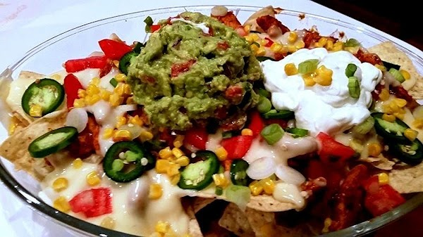 Once you have second layer. Sprinkle with tomatoes. Top with desired sour cream and...