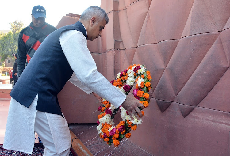 London Mayor Sadiq Khan places a wreath at the Jallianwala Bagh memorial in Amritsar, India, December 6, 2017.