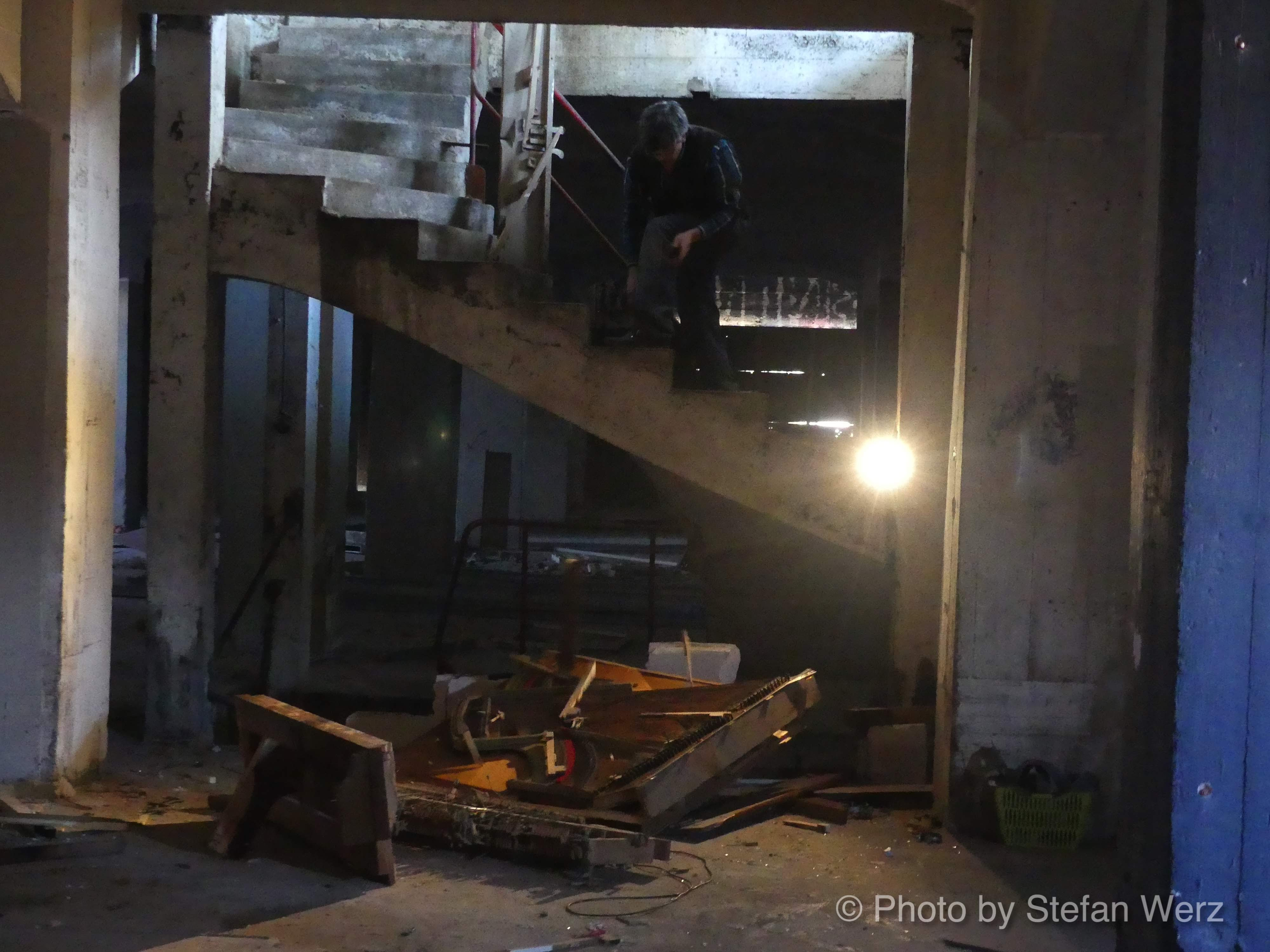 Photo: Action artist Mirko Siakkou Flodin Lagerhaus Film - shooting Zombi Piano, The Piano in Art, Soundsession, Photo curtesy Stefan Werz