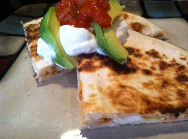 REMOVE TO PLATE CUT INTO FOUR PIECES N TOP WITH SOUR CREAM N AVACADO...