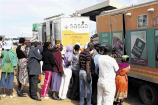 ON THE LINE: People queue in large numbers to apply for child support grants in Limpopo. Pic: MOYAHABO MABEBA. 01/02/2010. © Sowetan.