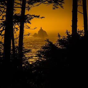 Tillamook Rock Lighthouse by Brent Huntley - Landscapes Sunsets & Sunrises ( sillhouette, oregon, brentsfavoritephotos.blogspot.com, park, silhouette, tillamook, ecola, lighthouse, state, rock, ocean, northwest, seascape, scenic, travel, seaside, glow, landscape, tamron, photography, coast, sky, sunset, terrible tilly, nikon, golden )