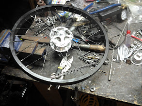 Photo: Back to working on the trike... just finished hand-cutting and threading the spokes for one of the front wheels.