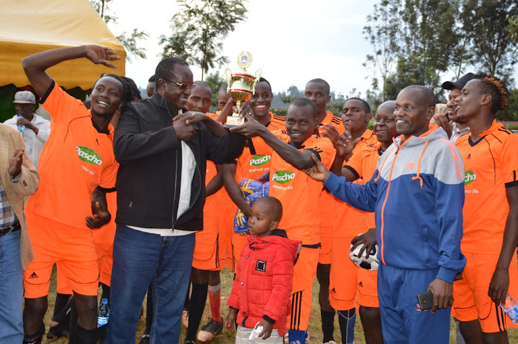Kiambaa MP Paul Koinange awards Rhino football team at Kiratina.