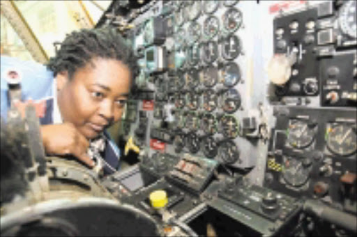 ELECTRONICS WHIZ: Sharon Kekana, quality controller at Denel Aviation Cargo. Pic: Elvis Ntombela. 21/08/2009. © Sowetan. 20090821 Sharon Kekana quality Auditor at Denel Aviation after  an interview with Sowetan at Denel Offices in Kampton Park, Johannesburg on the on the 21st August 2009 here working on an Uganda Air Cargo.  PHOTO: ELVIS NTOMBELA