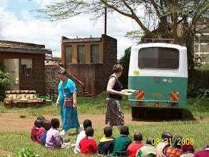 Photo: Team members bringing food to street children in Kibera.