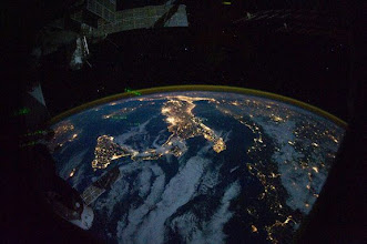 Photo: This photo taken by astronauts on the International Space Station shows the dazzling 'boot' of Italy lit up by city nights at night. Credit: NASA  See more amazing photos of Earth at night as seen from space in our full gallery here:  http://www.space.com/13380-photos-earth-cities-night-space.html