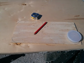 Photo: Creating a plywood template for the new quarterberth window.    Used an electrical tape canister for the corner radius.