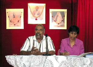 Photo: Mr Sivaji, President, and Mrs Usha, secretary, on the dais.