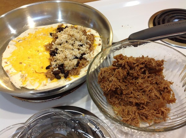 To make quesadillas, in large skillet, cover a whole tortilla with shredded cheddar. ...