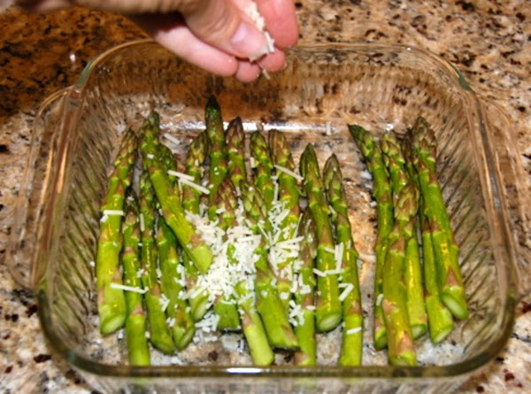 Sprinkle parmesan and pepper on top of asparagus. Place in oven.