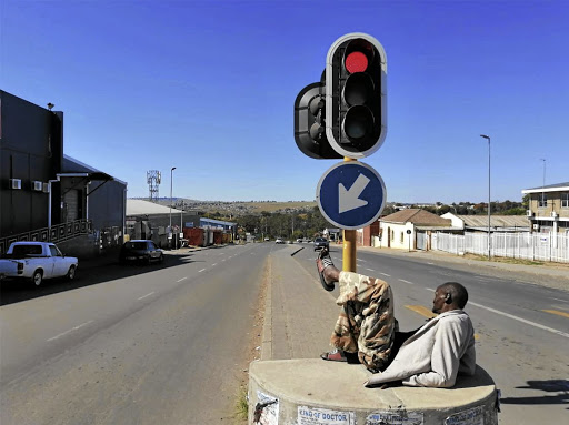 Mxolisi Lugano of Ngangelizwe takes a rest at the intersection of Nelson Mandela Drive and Madeira Road in Mthatha. /LULAMILE FENI