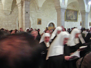 Photo: He was followed by a large number of nuns and then the rest of the congregation, all singing Christmas carols.