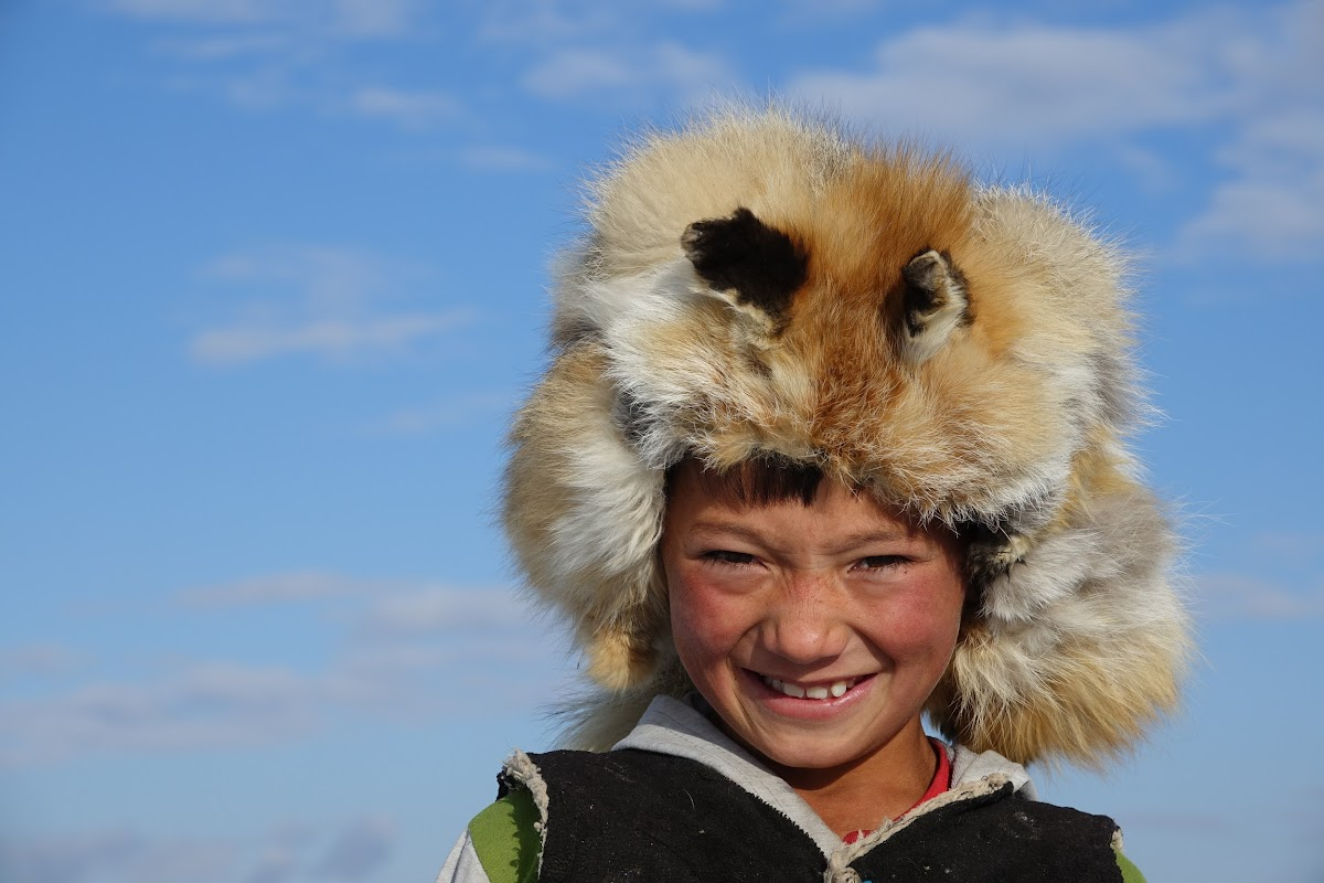 Arkhalykh proudly wearing his grandfather's fox hat