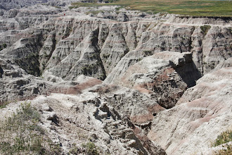 Photo: Badlands form in dry areas regions with soft sedimentary rocks and dry clay soils.