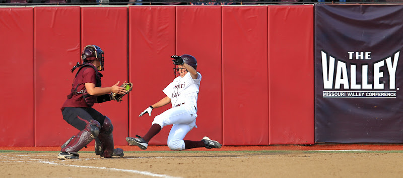 Photo: Softball Bear Ashley Brentz slides safely into home during the second game of a doubleheader against Southern Illinois on Saturday, April 14.