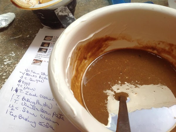 Now alternate the flour with the liquid mixture, in 3 intervals, ending with the...