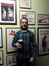 Photo: Myself in festive attire in front of Guinness memorabilia