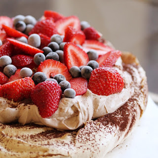 Chocolate Dusted Pavlova with Chocolate Cream and Berries.