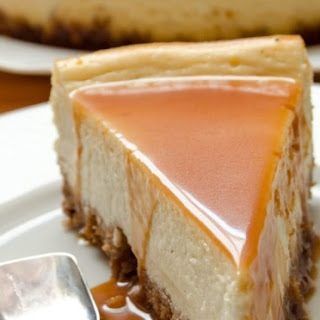 {White Chocolate Cheesecake with Amaretto Caramel Sauce}