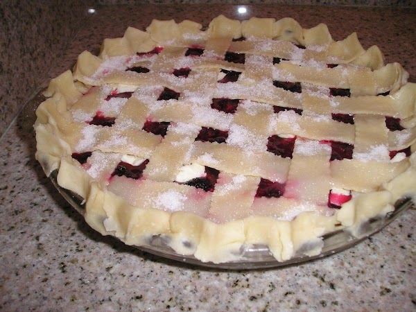 In a large bowl combine sugar, cornstarch & floor, mix well. Add berries and...
