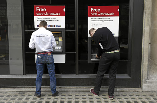 Withdrawal pain: Britons will probably have to pay higher transaction fees for cash withdrawals from ATMs in the EU after Brexit if the UK and the EU fail to reach agreement before March 2019, says an official UK document. Picture: REUTERS