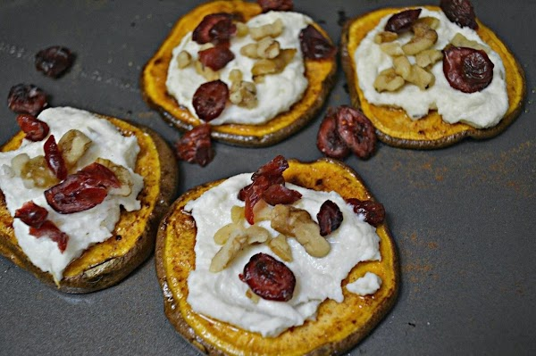 Serve on a platter with a dollop of the ricotta mixture on each round