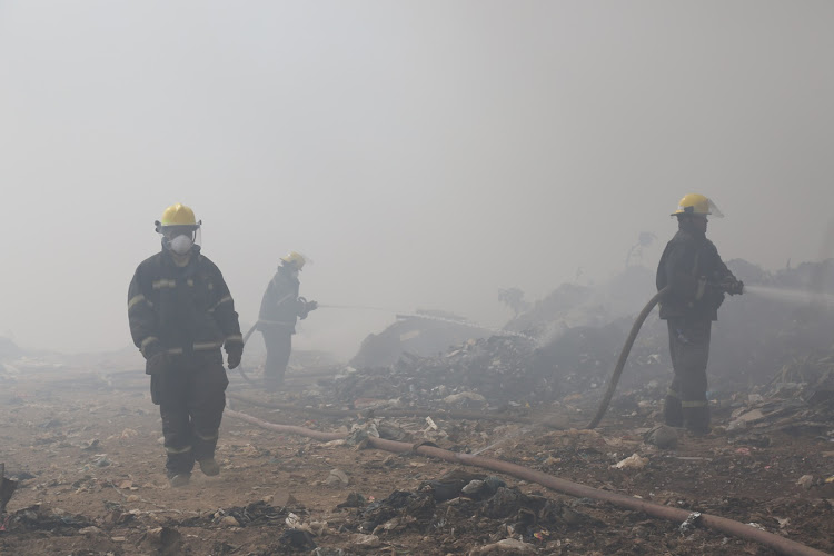 Fire fighters fight to put out a blaze at the Msunduzi landfill in Pietermaritzburg since yesterday.