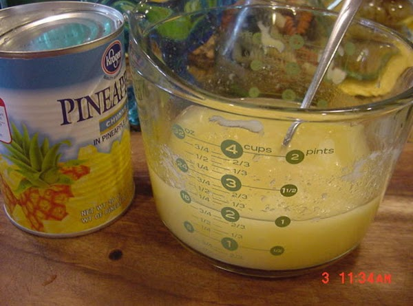 Drain the pineapple.  Reserve 1 cup of pineapple juice. Mix the pineapple juice with...