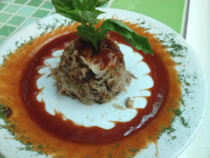 """La Lechoncita"" (Shredded Pork served over guava sauce)"