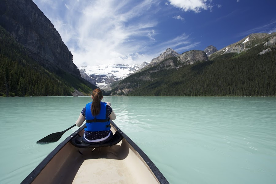 Lake Louise Canoe by Paul Young - Travel Locations Landmarks ( lake louise, glacier, mountain, canoe, lake )