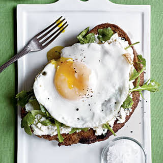 Open-Faced Sandwiches with Ricotta, Arugula, and Fried Egg.