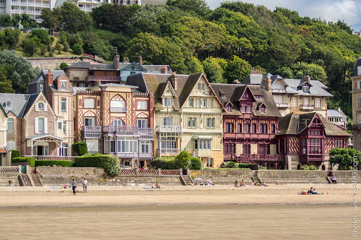 Grand old houses line the beach in Trouville sur Mer, Normandy, France.