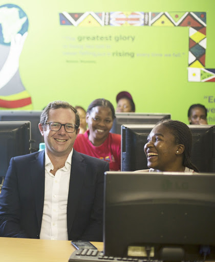 Edward Lawrence, Director and Founder of Workonline Communications with Afrika Tikkun learners.
