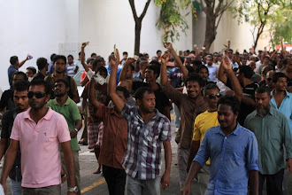Photo: A peaceful march in Male' after MDP Haruge was re-opened by President Nasheed on February 14th 2012, after it was set on fire and vandalized by the rebels and opposition party supporters. People chanted, 'money money, yes sir'